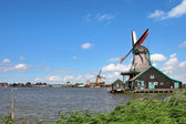 Wooden windmills in dutch village. — Stock Photo