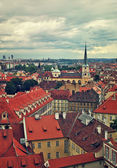 Red rooftops under cloudy sky in Prague. — Stock Photo
