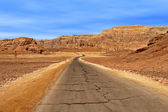 Road through red mountains in Timna park. — Stock Photo