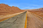 Road through red mountains in Timna park, Israel. — Stock Photo