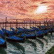Gondolas on Grand canal at sunset in Venice. — Stock Photo