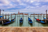 Gondolas on Grand Canal under overcast sky in Venice. — Stock Photo
