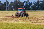 Tractor on agricultural field. — Stock Photo