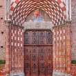 Old wooden door at the entrance to catholic church. — Stock Photo