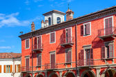Red two storey building in Alba, Italy. — Stock Photo