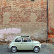 Retro car in front of ancient wall. — Stock Photo #6735232