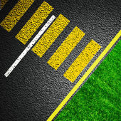 Asphalt as abstract background with grass — Stock Photo