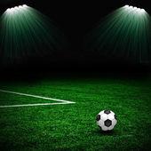 Balón de fútbol en el campo verde y rayo — Foto de Stock