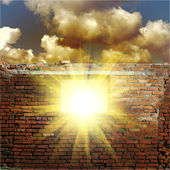 Sky with sunlight through the hole in the brick wall — Stock Photo