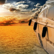 Stock fotografie: Private motor yacht to incredible sunset.Sailboat, motor boat