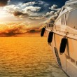 Stock Photo: Private motor yacht to incredible sunset.Sailboat, motor boat