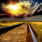 Blurred speedway railroad into the sunset — Stock Photo