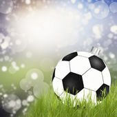 Golden christmas ball on the grass — Stock Photo