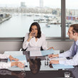 Latin businesswoman in an office with her team in an office — Stock Photo