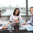 Stock Photo: Latin businesswomin office with her team in office