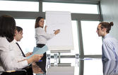 Group of office workers in a boardroom presentation — Stock Photo
