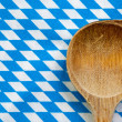 Antique wooden spoon for cooking with blue white background — Stock Photo