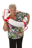 Female senior with life belt — Stock Photo