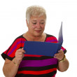 Senior female looking at statement of account — Stock Photo