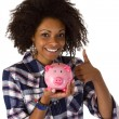 Female afro american with piggy bank - Stock Photo
