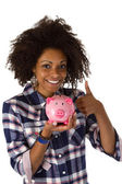 Female afro american with piggy bank — Stock Photo