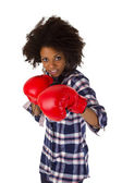 Female afro american with red boxing gloves — Stock Photo