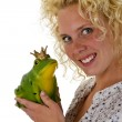 Young woman kissing a frog prince — Stock Photo #18324837