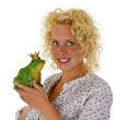 Young woman kissing a frog prince — Stock Photo
