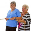 Two female seniors pulling on a rope — Stock Photo