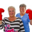 Two female seniors with red boxing glove — Stock Photo