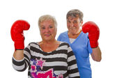Two female seniors with red boxing glove — Stok fotoğraf