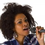Beautiful african american woman karaoke singer — Stock Photo #34776875