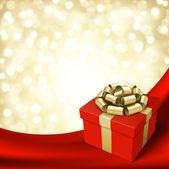 Rode geschenk met gouden boog op achtergrond zijden vector — Stockvector