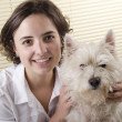 Young woman with her west highland terrier — Stok fotoğraf