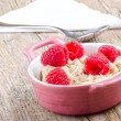 Porridge in a bowl with raspberry — Stock Photo #12838702
