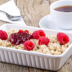 Porridge with raspberry and jam — Stock Photo #12838714