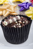 Chocolate cupcake with choco chrunchies — Stock Photo