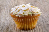 Home made cup cake with almond flakes — Stock Photo
