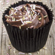 Stock Photo: Cup cake with chocolate buttercream