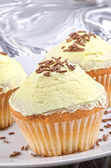 Cup cake with lemon buttercream — Stock Photo