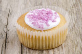 Home made cup cake with pink shimmer sugar — Stock Photo