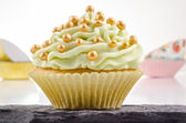 Cupcake with lime butter cream — Stock Photo