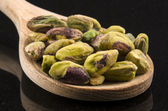 Pistachios on a wooden spoon — Stock Photo