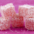 Sweet turkish delight on a pink background — Stock Photo