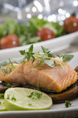 Grilled salmon filet on mushrooms — Stock Photo