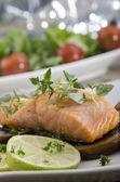 Grilled salmon filet on mushrooms — Stock Photo