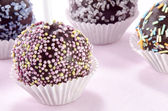 Cake pop with coloured sprinkles — Stock Photo
