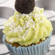 Lime cupcake with grated coconut — Stock Photo