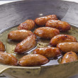 Stock Photo: British sausages in brass pan