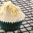 Cupcake with butter cream and lemon curls - Stock Photo